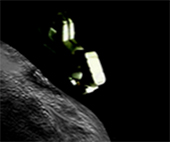 image of a spacecraft near an asteroid